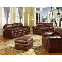 This handsome cognac brown bonded leather sofa and loveseat set possesses the appeal of an old, well-loved leather seat.