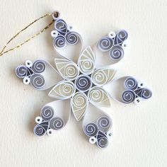 https://flic.kr/p/Bv4X4U | 6 point lilac and white small closed heart quilled snowflake