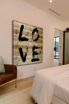 Distressed wood wall art. Light pink walls with tannish floor.