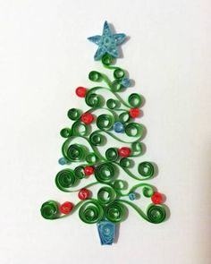 A quilled Christmas tree.  Great for festive greetings cards.