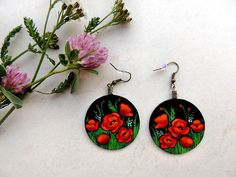 Hand painted romantic earrings, a lovely gift for a girlfriend, wife or sister. These red poppies earrings are made of several layers of cardboard, glued together and painted with acrylic.  Diameter:  Black big: 3.8 cm Black small: 2.4 cm  On the backside of any piece you can find my signature, my personal rakkan. It is a special Japanese personalized stamp, used with special ink, that says the artist´s name. The mine says Anna.   ATTENTION: the SHIPPING COSTS will never be more than 6.50…