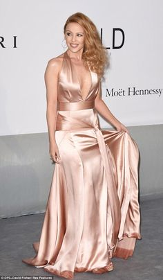 Kylie Minogue was another of the glamourous attendees at this year's amfAR Gala. The petite Aussie pop star put her own twist on old school Hollywood glamour Silk Satin Dress, Satin Dresses, Nice Dresses, Amazing Dresses, Hollywood Red Carpet, Hollywood Glamour, Kylie Minogue, Cannes, Silk Playsuit