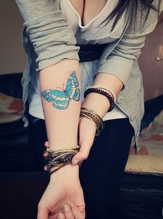 i want a butterfly a little smaller than this, in about this same spot on my arm..