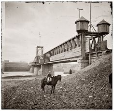 """Fortified railroad bridge across the Cumberland River at Nashville, 1864. """"Continuing his policy of the offensive at any cost, Gen. John B. Hood brought his reduced army before the defenses of Nashville, where it was overthrown by Gen. George H. Thomas on December 15-16, in the most complete victory of the war. If the date borne on this photograph is correct, it was taken in the course of the battle."""""""