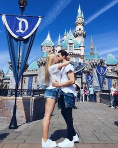 Pin for Later: 19 Cute Photo Ideas For Couples Headed to Disneyland Castle Kiss