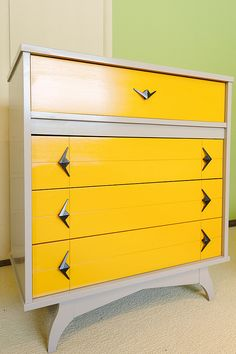 Painted mid century modern chest of drawers with contrasting drawers and angular hardware