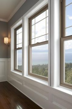 These are Tan vinyl windows from the Milgard® Tuscany® Series. Shown as three single hung windows with perimeter grids. View our photo gallery for more inspirational window ideas. Single Hung Windows, Big Windows, Windows And Doors, Modern Windows, Front Windows, House Windows, Interior Windows, Bedroom Windows, Interior Trim