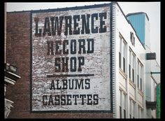 ghost sign for Lawrence Record Shop