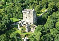 """Blarney Castle, Cork, Ireland. With a foundation that dates from 1200, this medieval fortification lies in partial ruin today but is still a sight to behold with its extensive gardens and the famous Blarney Stone. Also known as the """"Stone of Eloquence,"""" the Blarney Stone lies at the top of the castle and if visitors are so brave as to hang upside down (over a sheer drop) to kiss it, it is said that they will be granted the gift of eloquence."""