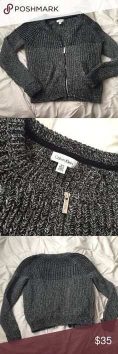 Calvin Klein Gray & Black Marled Zip Up Sweater Calvin Klein Gray & Black Marled Zip Up Sweater size Small - full zip, front pockets, thick knit sweater material.  ---- 🚭 All items are from a non-smoking home. 👆🏻Item is as described, feel free to ask questions. 📦 I am a fast shipper with excellent ratings. 👗I love bundles & bundle discounts. Feel free to make an offer! 😍 Like this item? Check out the rest of my closet! 💖 Thanks for looking Calvin Klein Sweaters