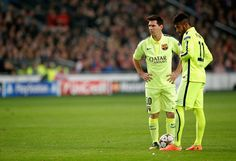 Lionel Messi and Neymar of Barcelona look on during the UEFA Champions League Group F match between AFC Ajax and FC Barcelona at The Amsterdam Arena on November 5, 2014 in Amsterdam, Netherlands.