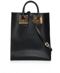 This black matte-leather tote has two top handles and a detachable shoulder strap with rose-gold plated hardware and signature buckles. The bag has a single internal slip pocket and comes with a gold tone spoon charm keychain. Leather, rose gold plated brass, leather lining.