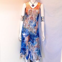 Reba Print Lace Dress Reba Printed Lace Maxi Dress. This beautiful Sleeveless, V-neckline, is absolutely stunning. The Lace Appliqué is studded with jewel detailing. Size Small. Body: 100% Polyester, Lining 100% Polyester. Hand Wash Cold. Excellent Condition. Reba Dresses Maxi