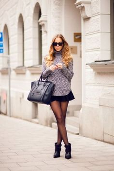 Cute. Heels, short skirt, pullover, big bag.