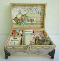{Pink-N-Pepper}: altered box filled with really cute sewing ephemera