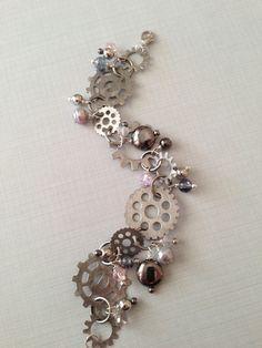 Pink ice steampunk bracelet. $20.00, via Etsy.