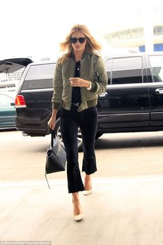 LA girl: Giving the outfit an edgier look, Rosie opted for a chic khaki green silk bomber and suede nude pumps