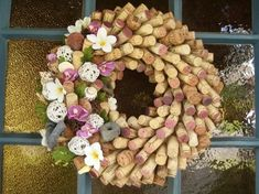 Wine Cork Wreath... I love how the corks are all used!  The dyed ends really give this wreath some color by tania