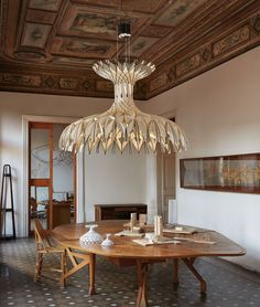 made of a network of interlocking wooden pieces, the pendant lamp is influenced by the pantheon in rome and santa maria del fiore in florence.
