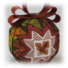"""****PLEASE NOTE – this listing is for a """"ready to ship"""" quilted ornament as shown in the pictures above. If you would like a PERSONALIZED ORNAMENT OR ANY CHANGES to the above ornament, please click on the link above """"Request a Custom Order"""" - thank you! ****  This handmade double sided Quilted Ornament measures 3"""" in diameter and is made with precisely folded material, a cross-stitch design on each side, many tiny sequin pins and topped with a hand sewn grosgrain bow on top. For more…"""