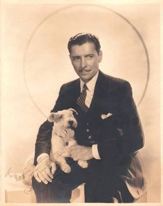 0 Ronald Colman with a terrier dog on his lap Old Hollywood Glam, Hollywood Star, Classic Hollywood, Ronald Colman, Star Wars, Puppies And Kitties, Classic Movie Stars, British Actors, Terrier Dogs
