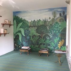 """""""Who doesn't love a library with a mural? We love how Nur Kaoukji decorated @28kothi library nook with our rug. You can find our collection of rugs online…"""""""