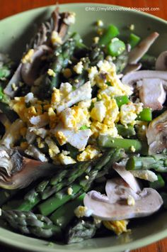asparagus artichockes and mushroom salad with crumbled egg