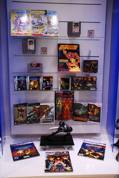 Metroid Franchise Cabinet at Nintendo World Nintendo Store, Nintendo World, Video Game Rooms, Video Games, Comic Book Storage, Metroid Samus, Video Game Collection, Video Game Industry, Gaming Merch