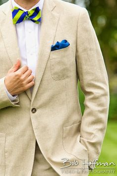Mens wear, fashion and style for the groom to be. Dressing up this khaki linen suit with a blue and green bow tie and matching blue pocket square. Photography: Bob Hoffman Photography & Video Location: Hilton Carlsbad Oceanfront Mens Wear: Class Act Tuxedo & J. Hilburn Stylists: Sydney Thom & Adam Walter Accessories: The Belle and the Beau (Etsy) & Shockey's Ties