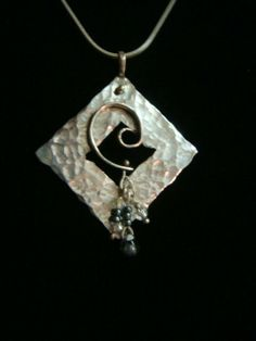 Sterling silver pendant with beads.  Copy Right-C. Bacon