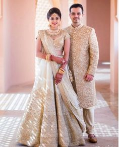 White Bridal Lehenga Photo white and gold lehenga Indian Lehenga, Sabyasachi Wedding Lehenga, Lehenga Sari, Bridal Lehenga Choli, Gold Lehenga, Floral Lehenga, Engagement Dress For Groom, Couple Wedding Dress, Indian Wedding Couple