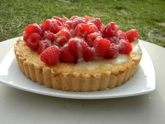 Fresh lemon tart with Lemoncello marinated raspberries