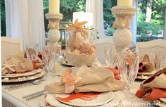 To make the centerpiece, I placed a smaller vase within a larger vase, then added sand and shells to the outer vase. Beach seafood lobster crab party coral sand tan