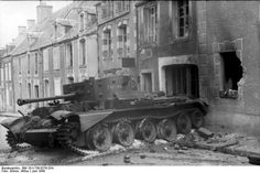 Normandy invasion, June 1944: Knocked out Cromwell Cruiser Tank VIII (A27M) in the village of Villers-Bocage. The Cromwell was the first tank put into service by the British to combine a dual-purpose gun, high speed from the powerful and reliable Meteor engine, and reasonable armour, all in one balanced package.The Cromwell first saw action in Normandy;t he tank equipped the armored reconnaissance regiments, of the Royal Armored Corps, within the 7th, 11th, and Guards Armored Divisions.