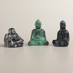 One of my favorite discoveries at WorldMarket.com: Mini Buddha Resin Statues, Set of 3