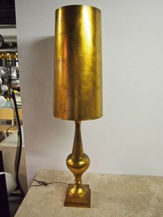 View this item and discover similar for sale at - Tall gilded table lamp with matching shade in the manner of James Mont. Storyboard, Manners, 1940s, Terrace, Lamps, Tables, Table Lamp, Shades, Exterior