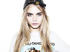 Channel cool Cara Delevigne vibes with a backwards baseball cap. Photo by Terry Richardson.