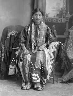 Flora Thundercloud Funmaker by Wisconsin Historical Images -- from the geometric ribbon work in her regalia, I believe she belongs to the Potawatomie People.  If not this Nation, then definitely from the Great Lakes area.