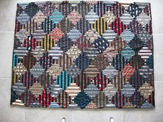 This is a quilt made with neckties & a wool suit--two things quickly becoming obsolete!