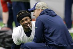 Seattle Seahawks running back Marshawn Lynch holds a candy cane in his mouth as he talks with offensive coordinator Darrell Bevell, right, before NFL football practice, Wednesday, Jan. 6, 2016, in Renton, Wash. Lynch has been recovering since having abdominal surgery last November. (AP Photo/Ted S. Warren) Photo: Ted S. Warren, Associated Press / AP