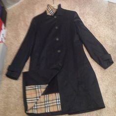 """Authentic Burberry zip out lined trench coat Gorgeous Authentic Burberry black microfiber Trench Coat With wool half zip out lining . Size 10 . 37 """" long from HPS . Authentic plaid under collar and inside coat under lining . Worn Twice . Burberry Hanger included - perfect condition ! Great for Spring and Fall !! Burberry Jackets & Coats Trench Coats"""