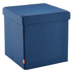 Navy Poppin® Box Seat, $39.99, Container Store. Carrie recommends boxes with lids or hinges if you're going to be storing kid stuff in family rooms so that it can all be tucked out of sight. This box can also be a seat.