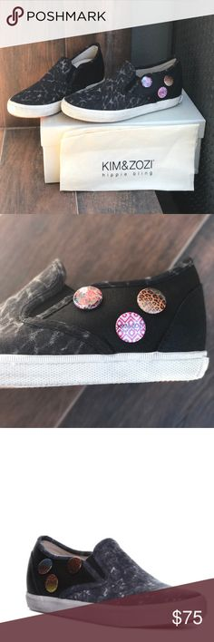 Black Distressed Denim Sneakers Sizing: True to size. - Round toe - Distressed denim construction - Slip-on - Button detail - Dual goring - Imported Materials: Leather/denim upper, rubber sole Urban Outfitters Shoes Sneakers