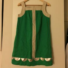 Hayden Harnett Tent dress with leather accents Pre-loved (worn only twice) Hayden Harnett mini tent dress in emerald green. Scalloped gold leather accents on the hem. Pockets. Linen and cotton. Needs to be pressed. Lined. laundry instructions: dry clean. Hayden Harnett Dresses Mini