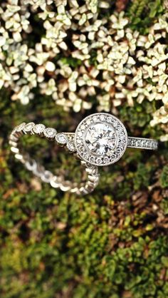 Pinterest : jasminecampos3   18K White Gold Round Bezel Halo Diamond Ring with Side Stones