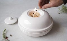 This ceramic smoker dish lets you add a flavorful aroma to all your meals.   19 Cooking Gadgets That Can Handle The Heat