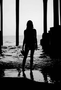 Silhouette under pier on beach. Galveston TX. Black and white. www.andrewwelchphotography.com http://www.facebook.com/AndrewWelchPhotography