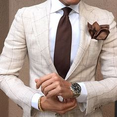 Large check suit, white shirt, brown tie and pocket square, watch. nice combination