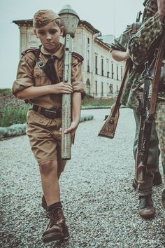 """feldgraugruppe: """" feldgrau_gruppeSince we started reenacting, we always had some Hitlerjugend in the group. Here is the latest arrival, Andreas. He is dressed with summer short trousers and brown shirt. He has his HJ knife and a panzerfaust..."""
