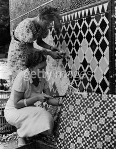 23rd July 1937: Women working on mosaics from the famous Alhambra Court at Crystal Palace, London. They are to be sold as souvenirs at a garden fete in aid of St Philip's Church at Sydenham. (Photo by Fred Morley/Fox Photos/Getty Images)